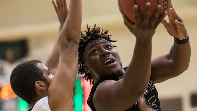 Michael Rogers, starring then for Cesar Chavez, goes for a basket against Basha's Nico Daal (left) on Dec. 1, 2016.