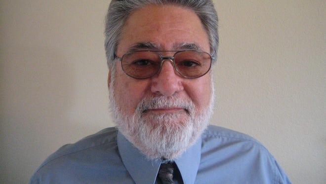 John M. Saludes