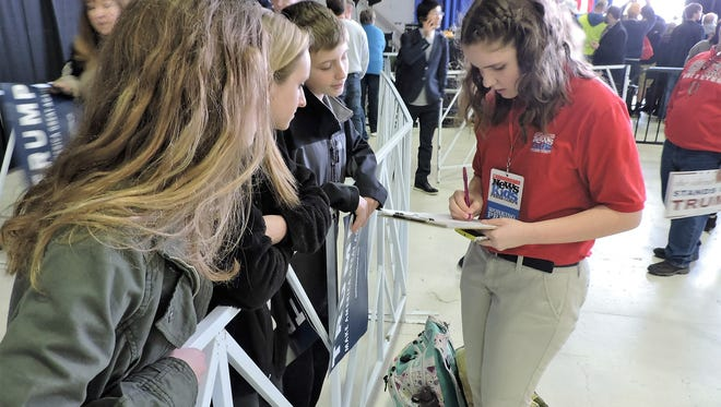 Kyra O'Connor, 15, interviews students at a rally for Republican presidential candidate Donald Trump in Columbus, Ohio, last month.