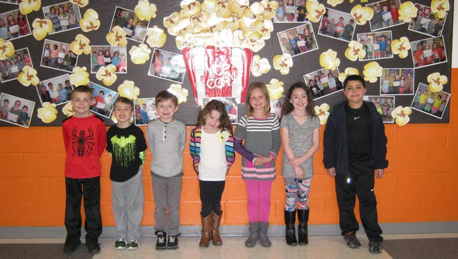 First-graders named Students of the Month for March at Janvier School in Franklin are: (from left) Bryce Remsen, Frederick Whitson, Dylan Farren, McKenzie Dotzel, Olivia Kepler, Jordan Shutts and Lukas Kanos.