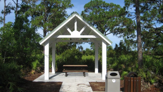 A pavilion is located along the primitive trail at Pinewood Trails Park.