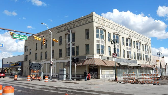The state of Michigan through its economic development arm will spend $750,000 to help rehabilitate a three-story building, pictured, at the intersection of Woodward Ave. and W. Grand Boulevard in the New Center section of Detroit.