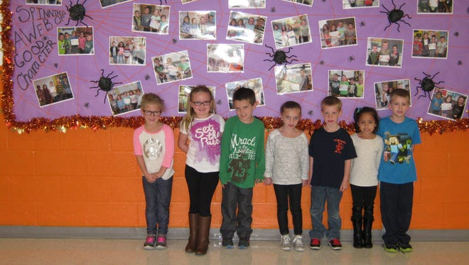 First-graders named Students of the Month for September at Janvier School in Franklin are: (from left) Maliah Powell, Bella Watson-Munyon, Patrick Driscoll, Leenie Falisi, John Harris, Gabriella Leon and Brandon Entrekin.