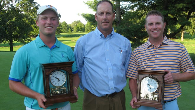 Noah Firestone, left, and Chris  Gebhard, far right, pose with Lebanon Country Club head pro Christian Sheehan and their W.B. Sullivan Invitational Four-ball championship clocks after winning last year's tournament.  Firestone and Gebhard will remain defending champs a little while longer after this year's event, originally slated to begin on Thursday, was postponed until Aug. 16-19 because of this week's heavy rain.