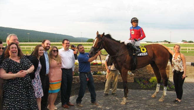 The connections of Hawkish accepted the Penn Mile trophy and much of the $500,000 purse.