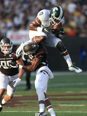 Michigan States Spartans Montae Nicholson intercepts a pass in front of the Western Michigan Broncos Carrington Thompson during first half action at Waldo Stadium in Kalamazoo Michigan on Friday, September 4, 2015.
