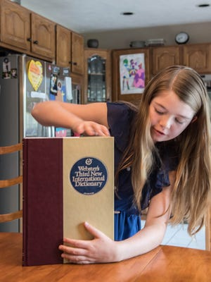 Lakeview Middle School seventh grader Leila Overbeek will return to the Scripps National Spelling Bee later this month. In this photo from 2016, she shows off a dictionary she won in a bee.