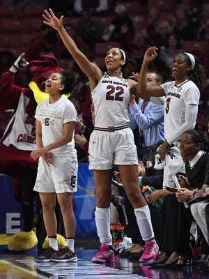From left, South Carolina's Victoria Patrick (0), A'ja Wilson (22), and Kaela Davis (3) react after a Gamecock 3 point shot against Georgia during their SEC women's basketball tournament game at Bon Secours Wellness Arena on Friday, March 3, 2017.