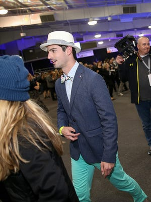 Alex Rossi, winner of the 100th Indianapolis 500, greets party-goers during the 2017 Rev party at Indianapolis Motor Speedway, Saturday, May 6, 2017. The party, hosted by Methodist Health Foundation, raises funds for IU Health statewide trauma programs and helps kick off Indianapolis 500 festivities.