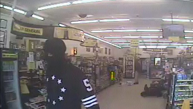 Surveillance photo of the Dollar General robbery suspect.