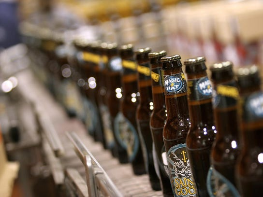 Bottles of beer travel down an assembly line at Magic