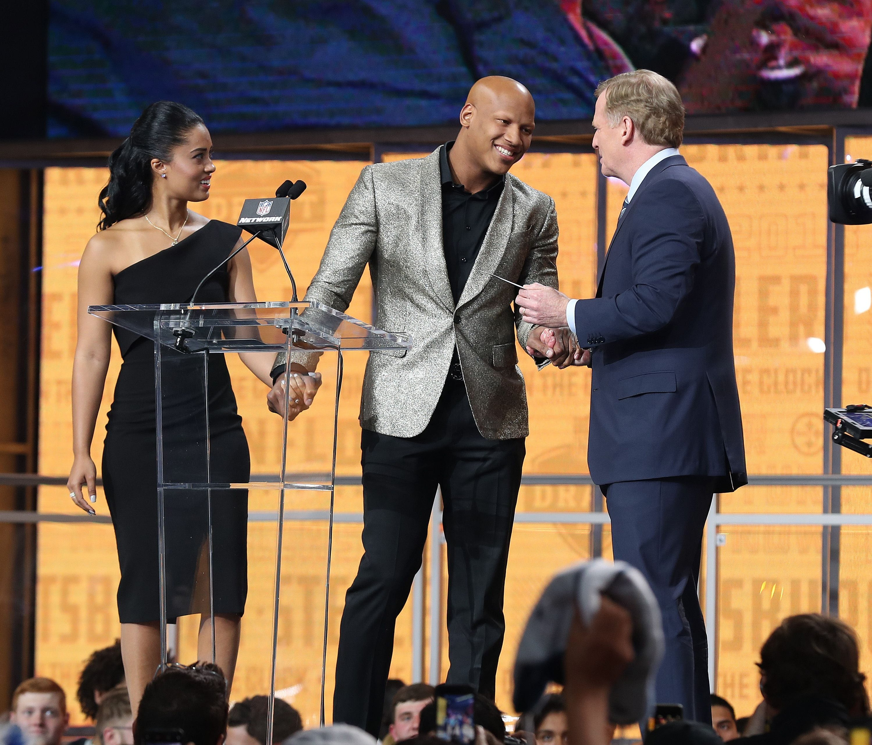 Pittsburgh Steelers linebacker Ryan Shazier walks across the stage with his fiancee Michelle Rodriguez is greeted by NFL Commissioner Roger Goodell to announce the No. 28 pick for the Pittsburgh Steelers in the first round of the 2018 NFL Draft at AT