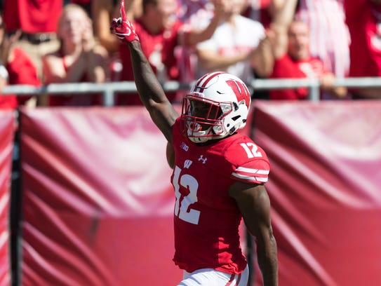 Badgers safety Natrell Jamerson celebrates after returning