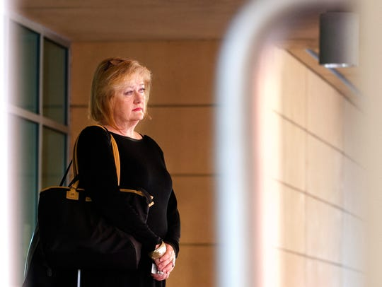 Charlotte Braden waits to appear before a bankruptcy