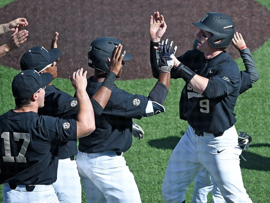 Vanderbilt's Will Toffey (9) is congratulated after