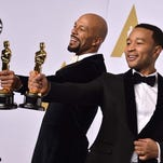 "AP10ThingsToSee - Common, left, and John Legend pose in the press room with the award for best original song in a feature film for ""Glory"" from ""Selma"" at the Oscars on Sunday, Feb. 22, 2015, at the Dolby Theatre in Los Angeles. (Photo by Jordan Strauss/Invision/AP)"