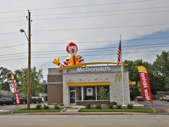 Ronald McDonald peeks up over the top of the newly