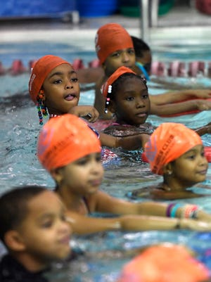 """Children in the seven-year-old age group, or the """"Dolphin"""" group, wait for instruction from the lifeguards at the Paterson Boys and Girls Club on Tuesday, July 31, 2018. The ZAC Foundation hosted the camp to teach children about water safety."""