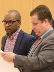 Ronald Greenland, left, at his Feb. 27 sentencing for attempted murder of a police officer. At right is his attorney Richard Ferrante.