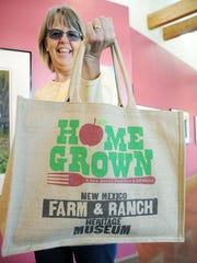 Alison Farley, of Las Cruces, holds out her HomeGrown burlap bag full of the local salsas she bought on Saturday at the New Mexico Farm & Ranch Heritage Museum during the museum's inaugural event, HomeGrown: A New Mexico Food Show & Gift Market, last year.