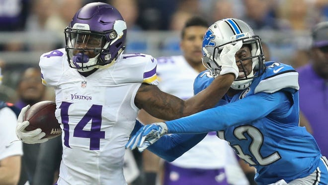 Detroit Lions' Nevin Lawson tackles Minnesota Vikings' Stephon Diggs during first half action.