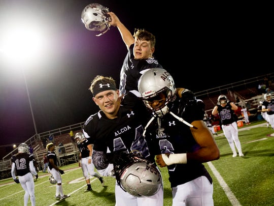 AlcoaÕs Landon Ray (44), Kareem Rodriguez (6) and Lucas McKeehnan (58) celebrate their win during a game between Austin-East and Alcoa at Alcoa High School in Alcoa, Tennessee on Friday, October 27, 2017.