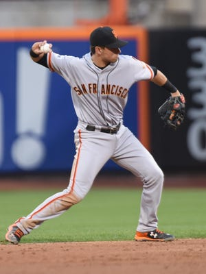 San Francisco Giants second baseman Joe Panik looks to throw in the infield during a 2015 game against the New York Mets at Citi Field in New York.
