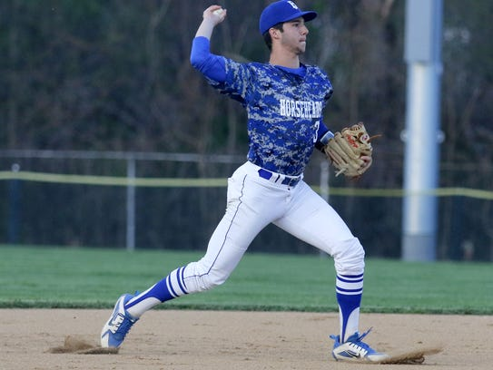Horseheads shortstop Mike Limoncelli throws to first