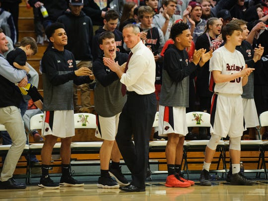 Rutland head coach Mike Wood and the bench celebrate