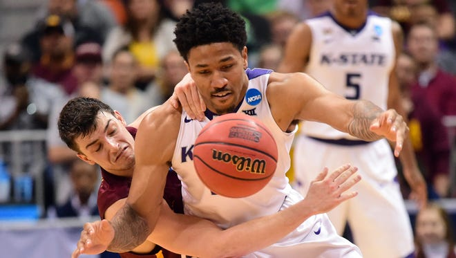 Kansas State guard Amaad Wainright fights Loyola guard Clayton Custer for a loose ball during the championship game of the South regional of the 2018 NCAA tournament.