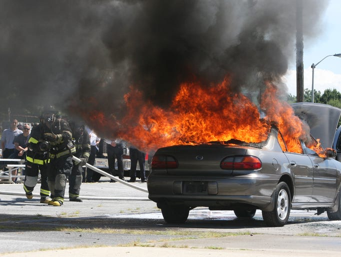 Firefighters at the Westchester County Fire Training Center in Valhalla Aug. 19, 2014, prepare to extinguish a car fire, during a demonstration of a product called F-500, an encapsulator agent for fire suppression and spill control. The seminar and demonstration were sponsored by Hazard Control Technologies, AAA Emergency Supply in North White Plains and the Westchester County Fire Training Center. The agent, when mixed through the firefighters hose, would use about 40 gallons of water instead of about 300 gallons of water.