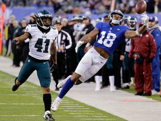 New York Giants wide receiver Roger Lewis Jr. (18) is unable to make a catch on a pass from quarterback Eli Manning, not pictured, as Philadelphia Eagles cornerback Ronald Darby (41) defends during the second half of an NFL football game Sunday, Dec. 17, 2017, in East Rutherford, N.J. (AP Photo/Seth Wenig)