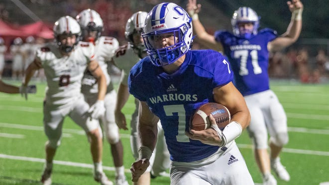 Oconee County Wide Receiver West Weeks (7) runs the ball in for a touchdown during a high school football game between North Oconee High School and Oconee County High School in Watkinsville, Ga. on Friday, Sept. 4, 2020. The Oconee County Warriors won 27-7.