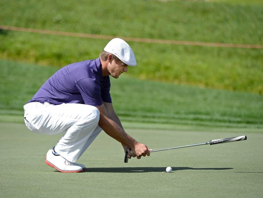 Bryson Dechambeau of the Unites States aims on the 13th green during the round one of Abu Dhabi HSBC Golf Championship in Abu Dhabi, United Arab Emirates, Thursday, Jan. 21, 2016. (AP Photo/Martin Dokoupil)