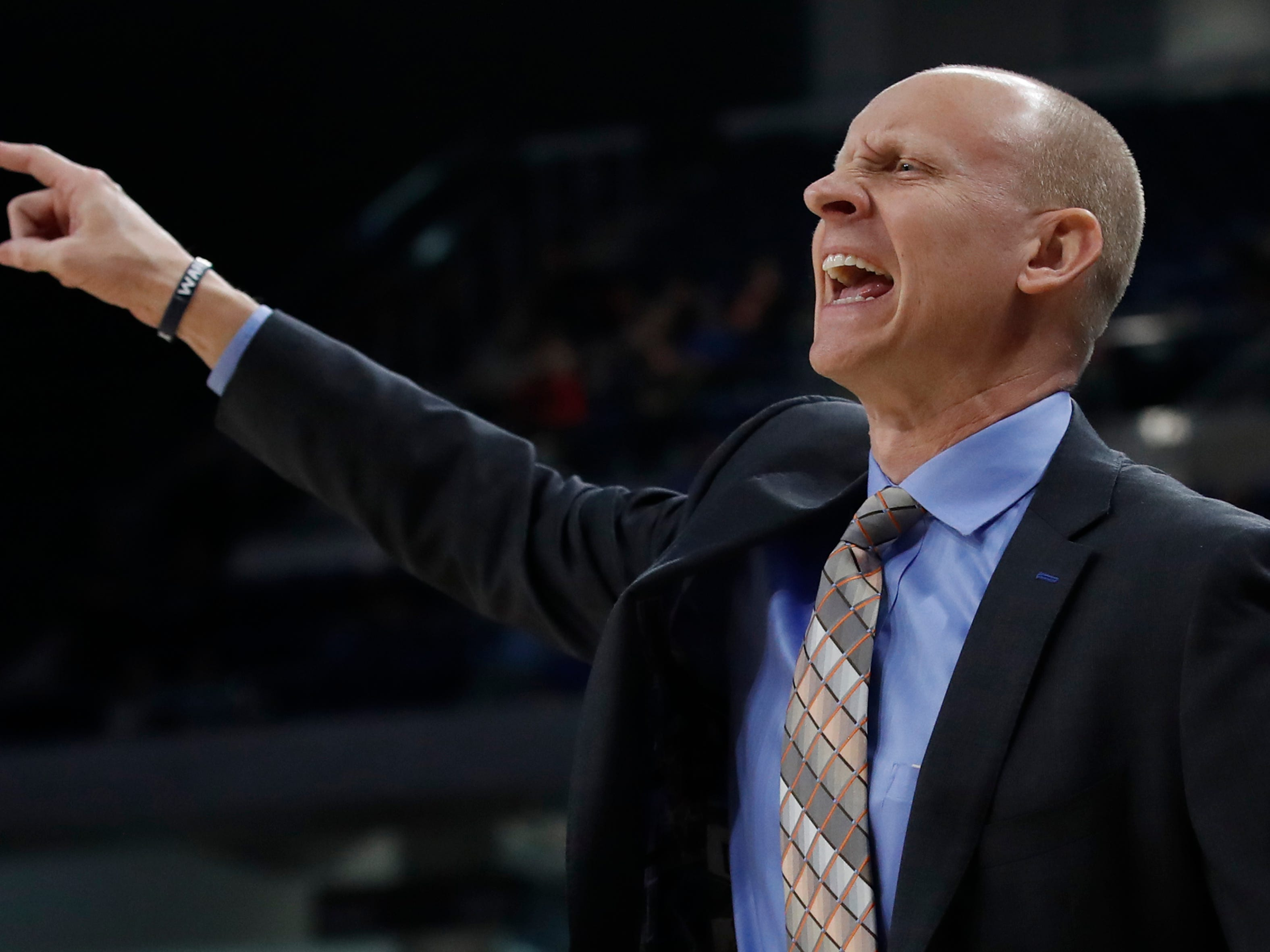 Xavier coach Chris Mack calls out to his players during the second half of an NCAA college basketball game against DePaul, Saturday, March 3, 2018, in Chicago, Ill. (AP Photo/Jim Young)