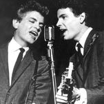 This July 31, 1964 file photo shows Don Everly and Phil Everly of The Everly Brothers during a performance. The Rock and Roll of Fame will honor the Everly Brothers with a tribute concert this fall. The Rock Hall announced Thursday that surviving member Don Everly will appear at the Oct. 25 event at PlayhouseSquareís State Theatre in Cleveland. Phil Everly died from chronic obstructive pulmonary disease earlier this year. The Everly Brothers were inducted into the Rock Hall in 1986 and the Country Music Hall of Fame in 2001.