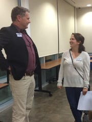 Candidate Chris Cotton talks after a forum Tuesday