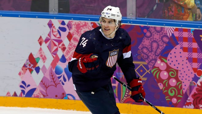 USA forward T.J. Oshie celebrates after scoring a goal in the shootout against Russia.