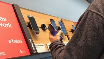 A customer checks out the Samsung Galaxy S8 at a Verizon store at the Garden State Plaza mall in Paramus, NJ.