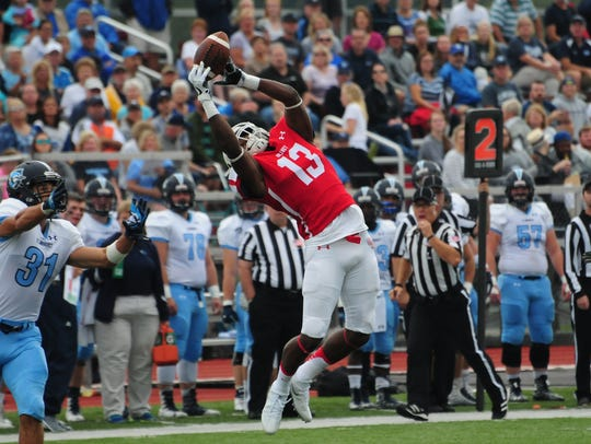 Olivet College receiver Kornelius Saxton makes a reception
