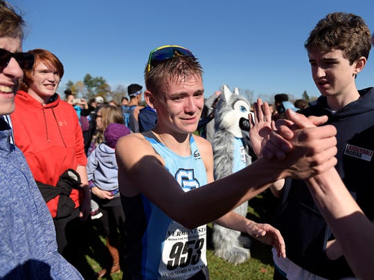 Lucas Calcagni of South Burlington, right, is congratulated after winning the Division I title at the Vermont Cross Country Championships at Thetford Academy on Saturday, Oct. 28. (Photo by Paul Hayes)