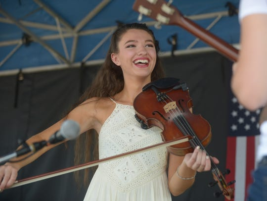 Ivy Phillips plays fiddle with Maddie Denton at the