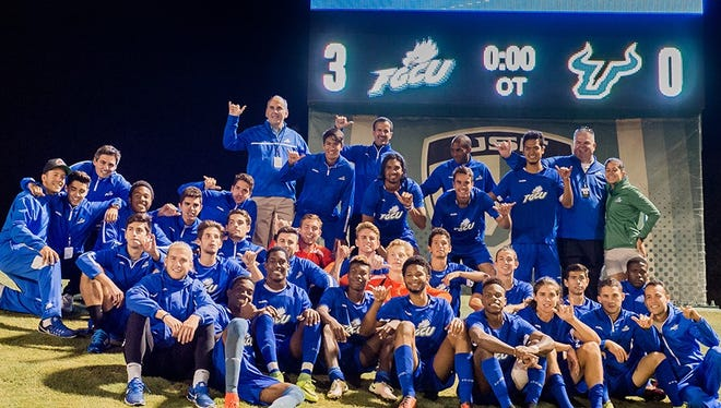 The FGCU men's soccer team celebrates advancing for the first time in the NCAA tournament, 3-0 on penalty kicks over USF after a 2-2 tie Thursday, Nov. 17 at USF's Corbett Stadium in Tampa.