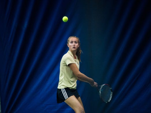 Delone Catholic's Ellie Neudecker keeps an eye on the