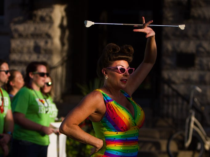 A Kentuckiana Pride Parade performer twirls a baton