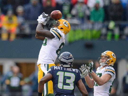 Green Bay Packers tight end Brandon Bostick bobbles an onside kick by the Seattle Seahawks during the NFC championship game in Seattle. The Seahawks recovered.