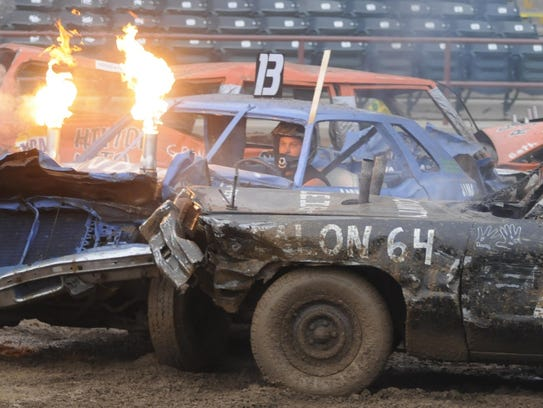 Demolition derby contestants entertain the crowd at