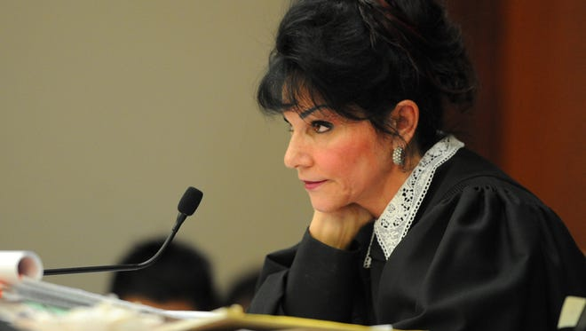 Judge Rosemarie Aquilina looks at the defendant Larry Nassar as she sentences him to 40-175 years in Lansing, Michigan Wednesday, Jan. 24, 2018.