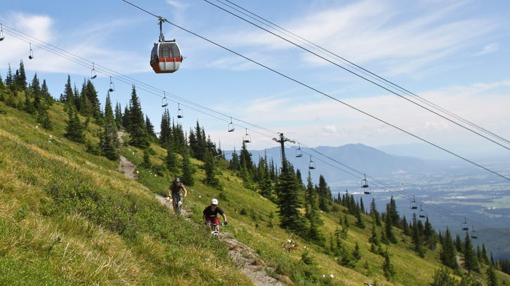 Mountain bikers make their way down a trail at Whitefish Mountain Resort. Whitefish offers nearly 30 miles of mountain bike trails in the summer.