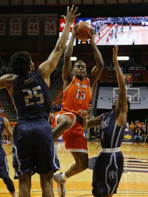 Dominc Artis (15) splits two Old Dominion defenders while going up for a shot. UTEP battled ODU for third place in Conference USA. Story and score at elpasotimes.com